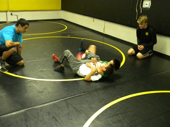Geoff and Michael help some of the campers  out with a cradle.